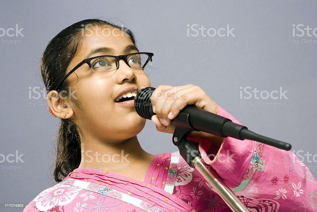 One Cute Little Indian girl with Microphone stock photo