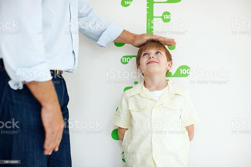 One day I'll be tall as you, dad! stock photo