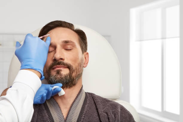 ein tag in der klinik für ästhetische medizin - nadeldesigns stock-fotos und bilder