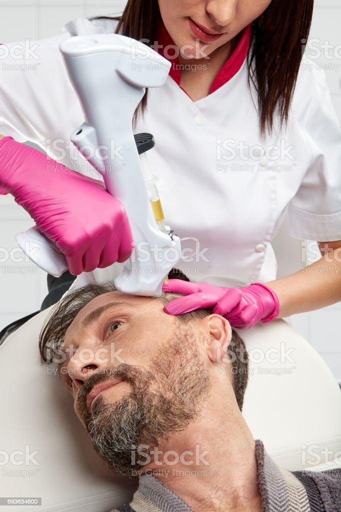 One day in the clinic of aesthetic medicine stock photo