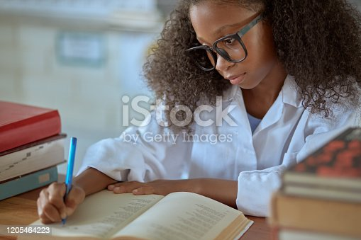 868148002 istock photo One day she'll be teaching her own class 1205464223