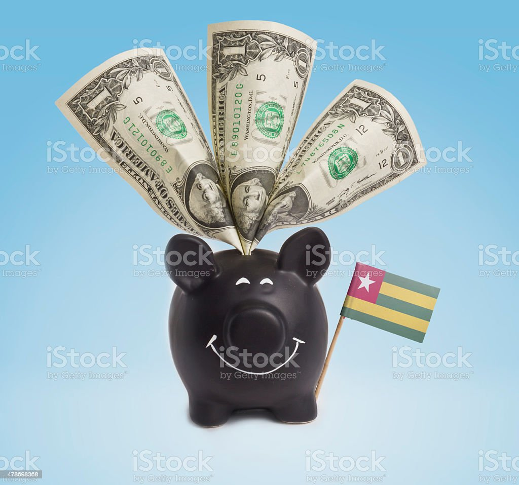 One dollar banknotes in a happy piggybank of Togo.(series) stock photo
