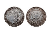 USA One Dollar Morgan Silver Coin replica dated 1880 with a portrait image of Liberty on the obverse and a spread eagle on the reverse cut out and isolated on a white background