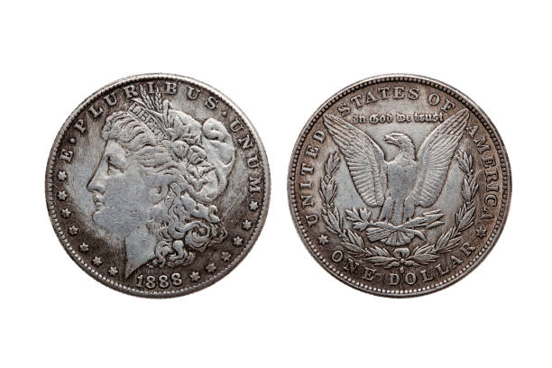USA One Dollar Morgan Silver Coin USA One Dollar Morgan Silver Coin replica dated 1880 with a portrait image of Liberty on the obverse and a spread eagle on the reverse cut out and isolated on a white background 1880 stock pictures, royalty-free photos & images