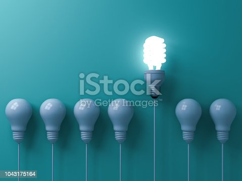 istock One eco energy saving light bulb glowing and standing out from unlit incandescent white bulbs on green pastel color wall background  leadership and different creative idea concepts 3D rendering 1043175164