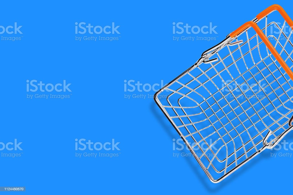 One empty market basket made from chrome metal wire and orange rubber...