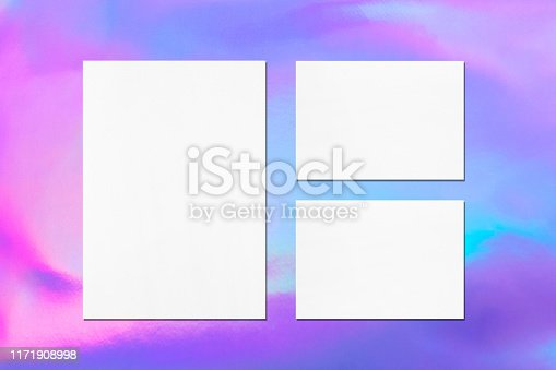 istock One empty white vertical a4 sized poster and two a5 sized horizontal rectangle card mockups on holographic background 1171908998