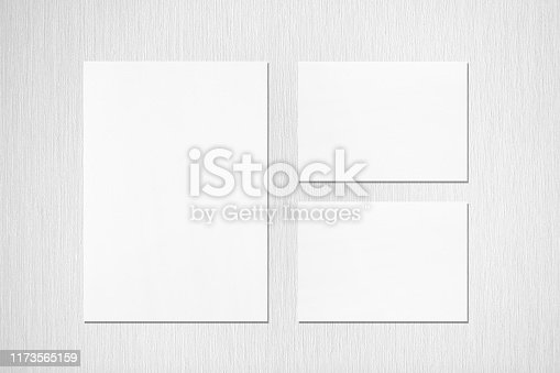 istock One empty white vertical a4 sized poster and two a5 sized horizontal rectangle card mockups on neutral light grey textured background 1173565159