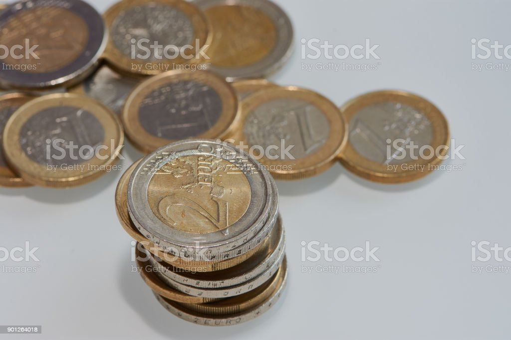 One euro and two Euro coins on white background stock photo