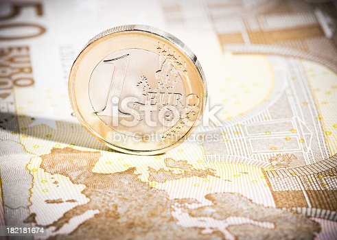 istock One Euro coin on €50 note map macro 182181674