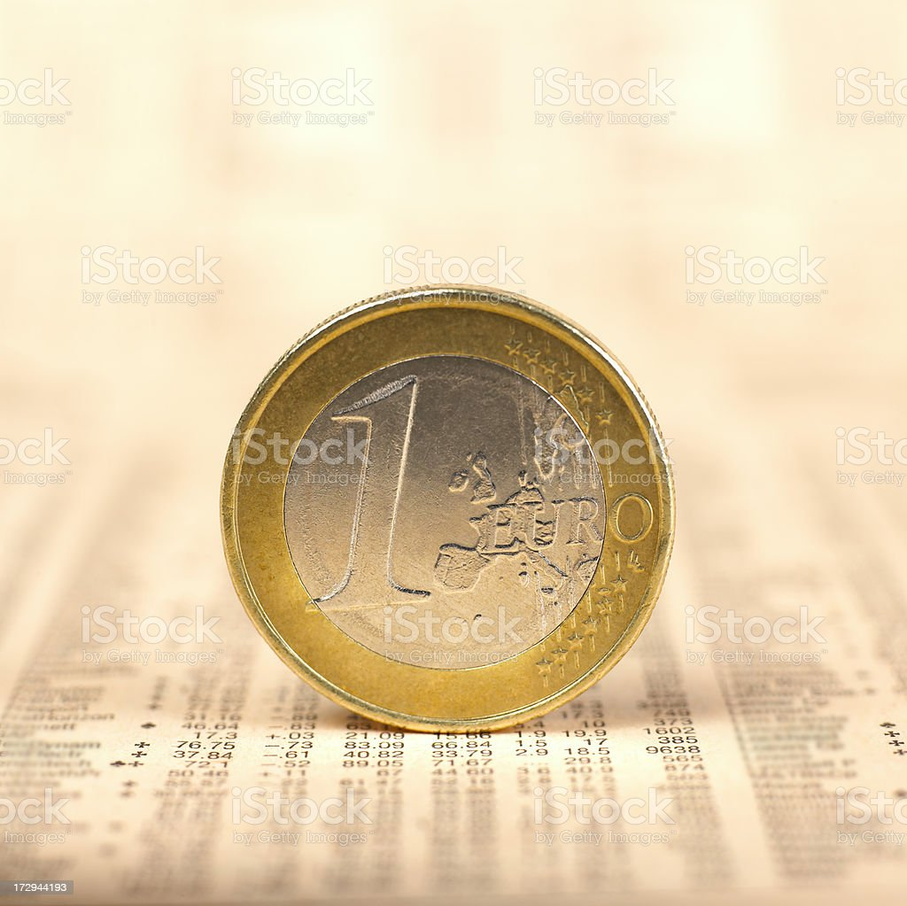 One Euro coin on financial newspaper stock photo