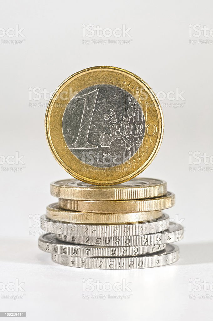 one euro coin on stacks of euros royalty-free stock photo