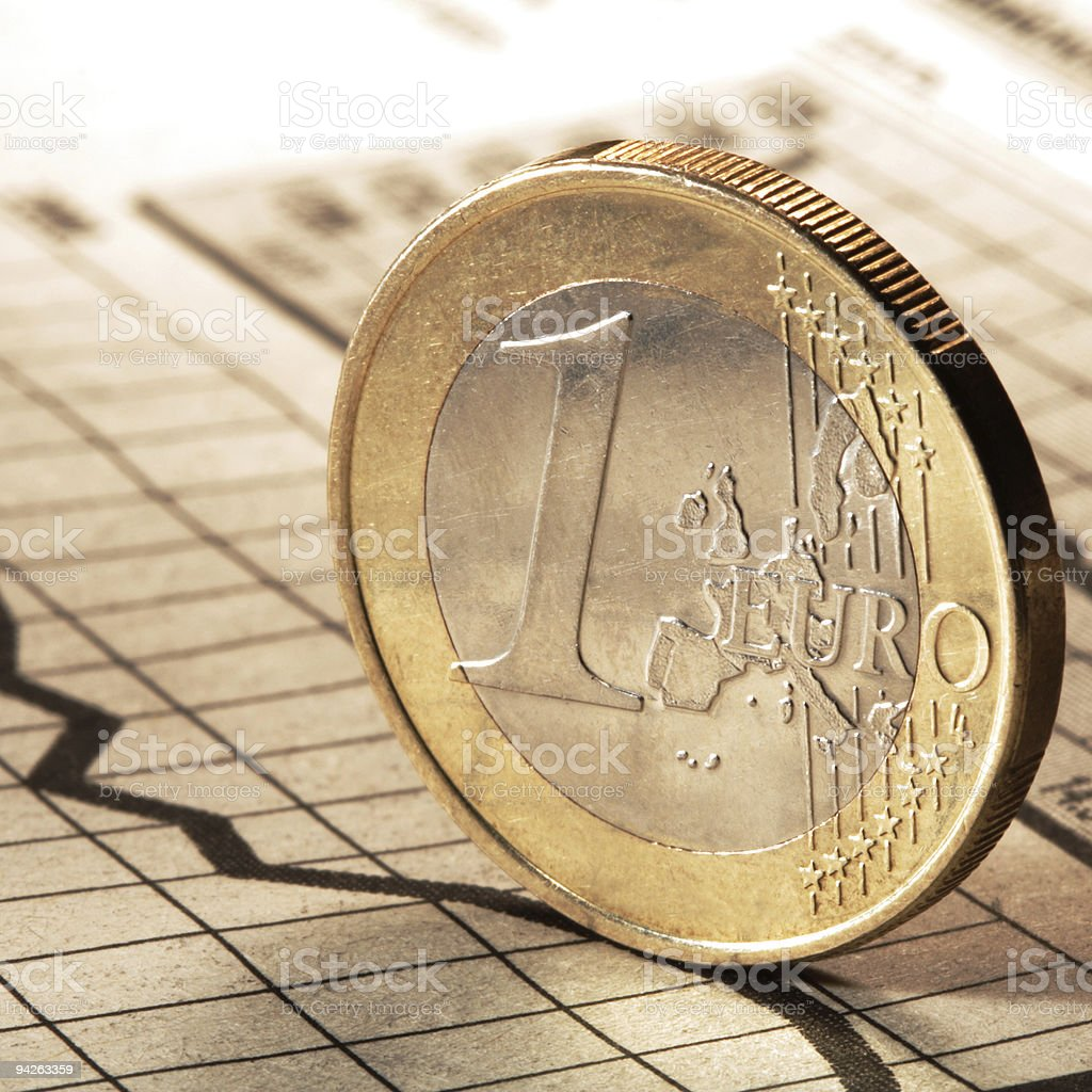 one euro on newspaper chart royalty-free stock photo