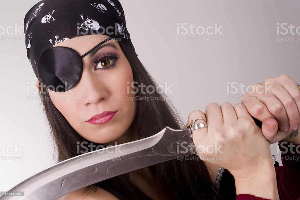 One Eyed Female Pirate Showing Her Large War Blade stock photo
