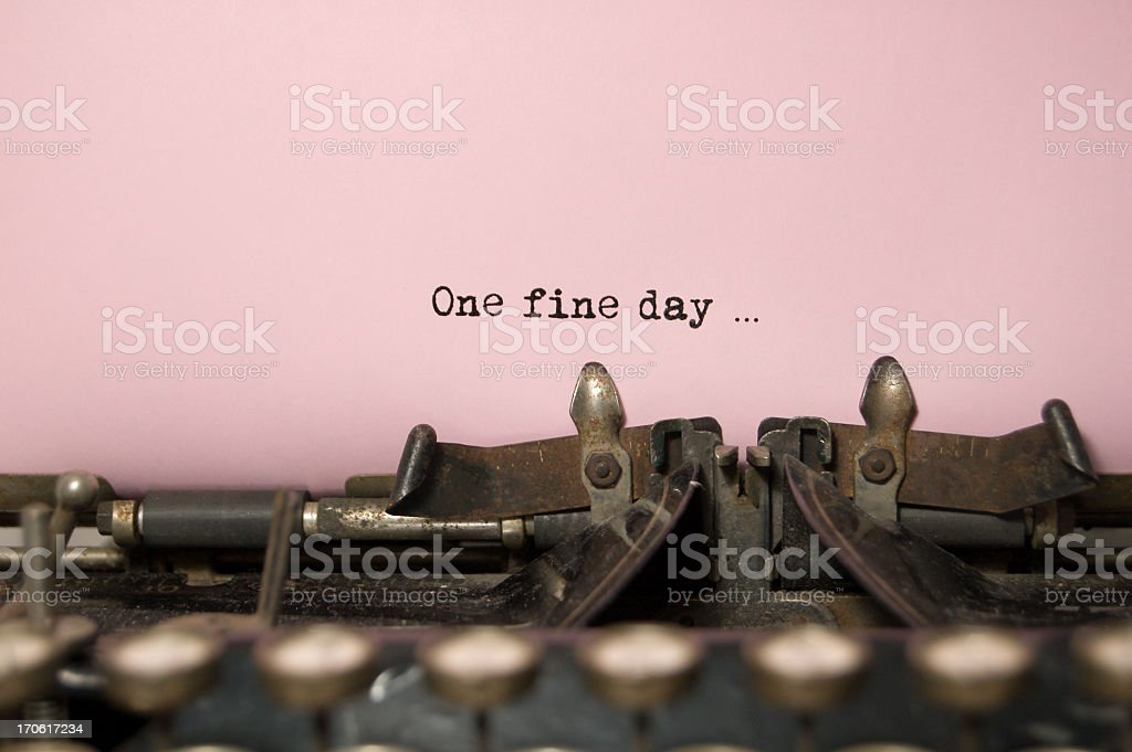 One Fine Day....on antique typewriter stock photo