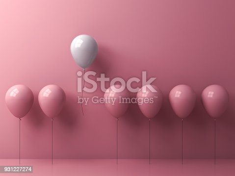 807463794istockphoto One freedom white balloon flying away from other pink balloons on pink pastel color wall background 931227274