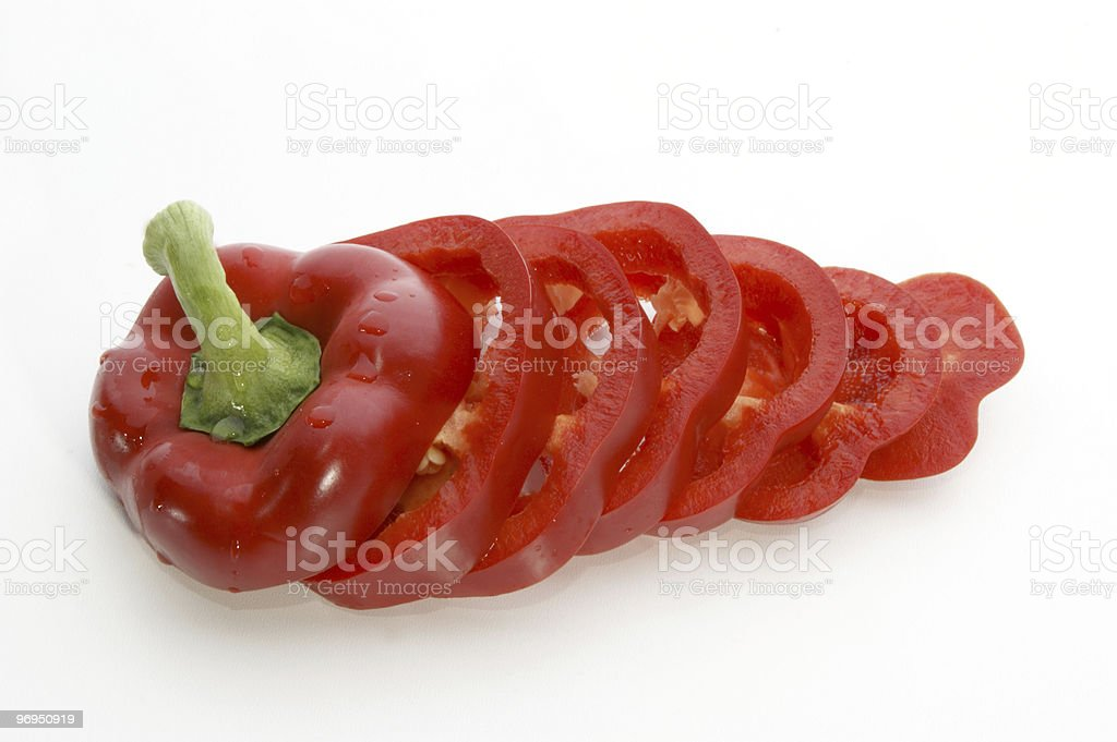 one fresh red paprika cut into slices royalty-free stock photo