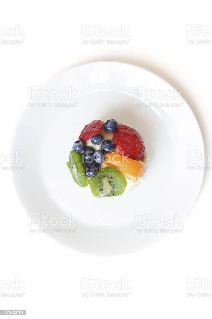 One fruit tart on a white plate royalty-free stock photo