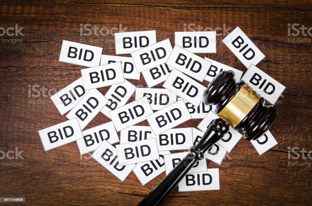 One gavel like those used on auctioning stock photo