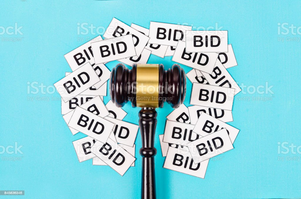 One gavel like those used on auctioning with the word bid stock photo