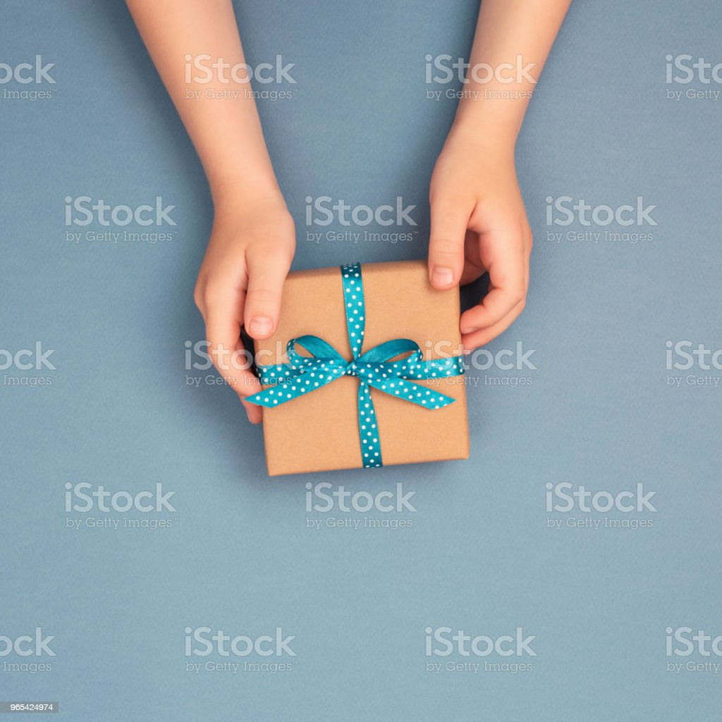 One gift box wrapped in kraft paper. royalty-free stock photo