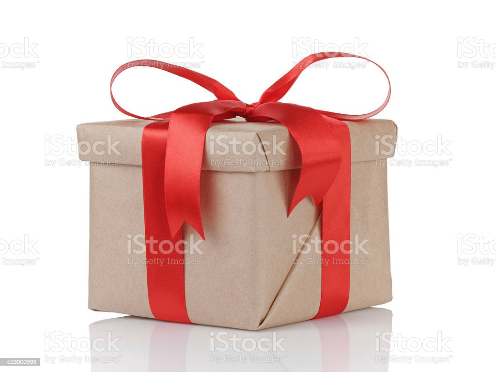 one gift christmas box wrapped with paper and red bow stock photo