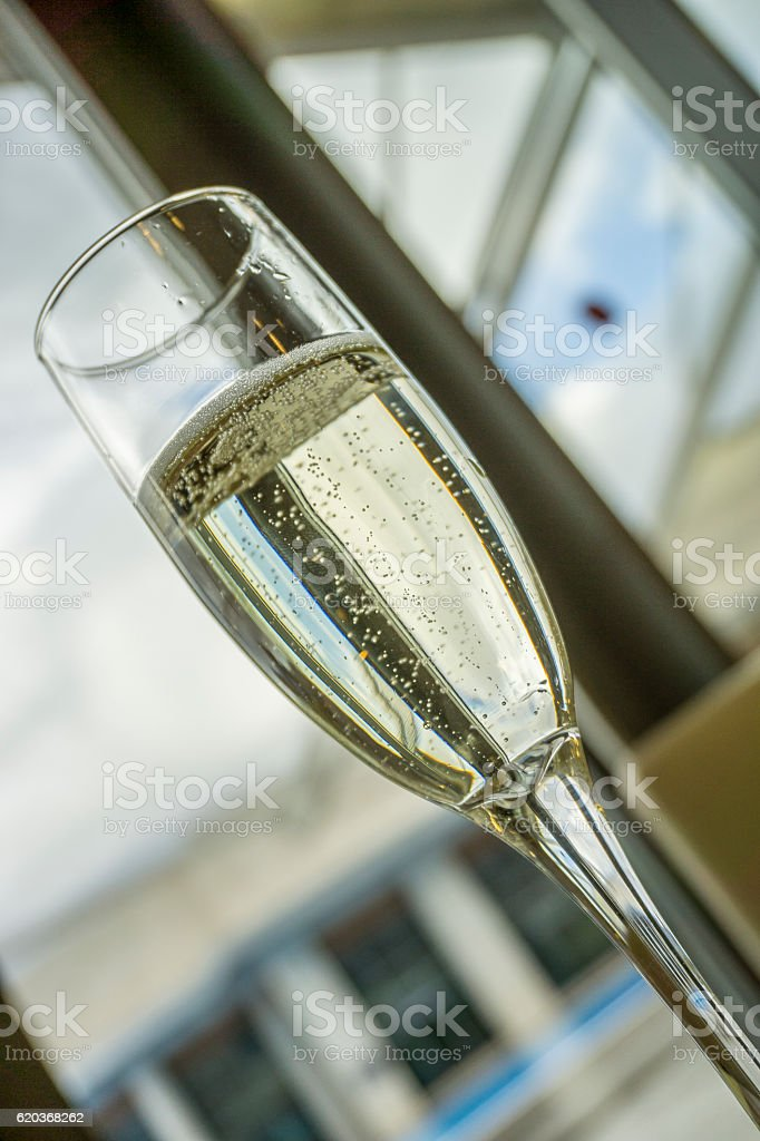 One glass of champagne waiting to be served by guests zbiór zdjęć royalty-free