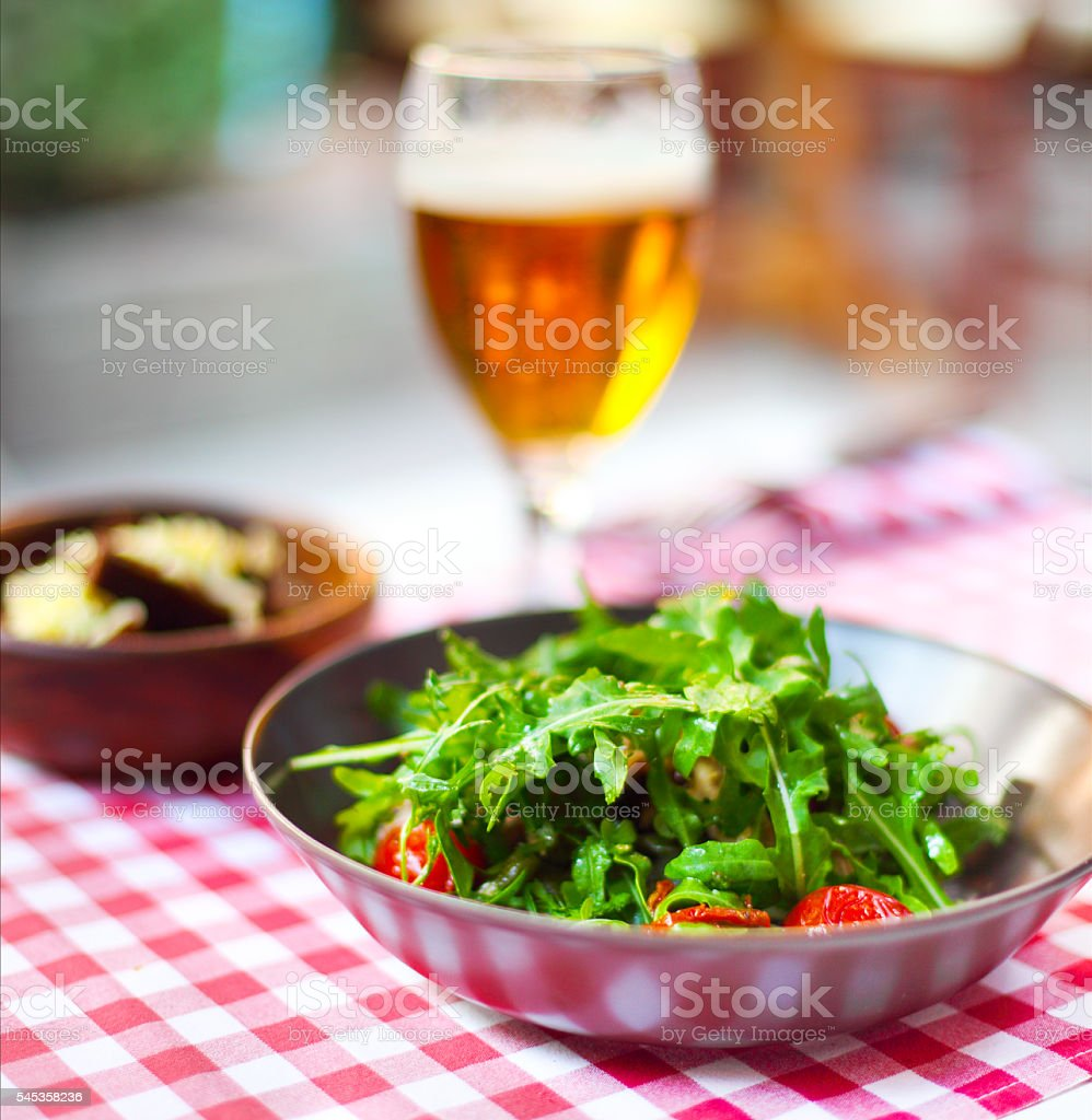 One glass of light beer with salad stock photo