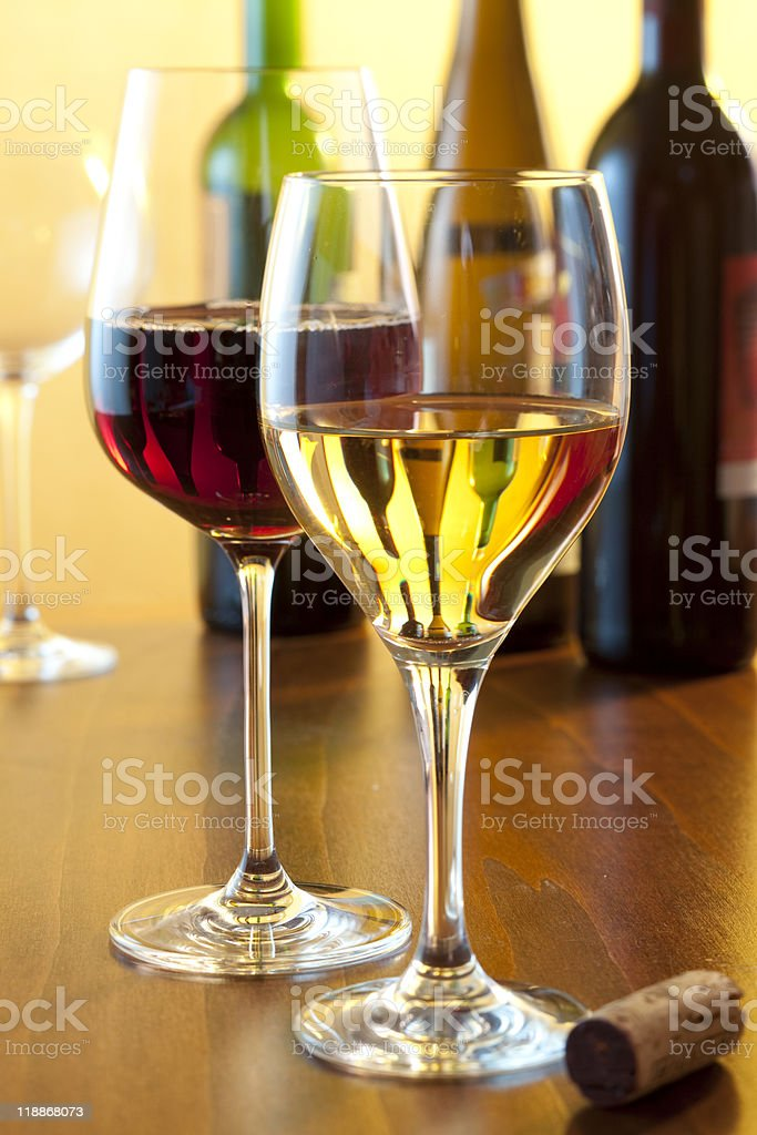One glass of red and one glass of white wine on the table royalty-free stock photo