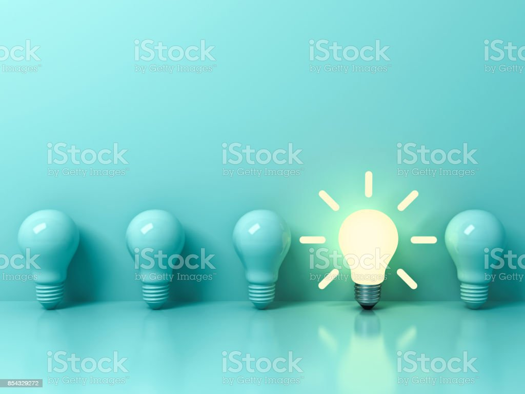 One glowing idea bulb standing out from unlit incandescent bulbs on light green pastel color background with reflection and shadow , individuality and different creative idea concepts . 3D rendering stock photo