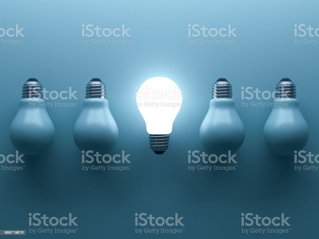 One glowing light bulb standing out from the unlit incandescent bulbs on cyan background with reflection and shadow , individuality and different creative idea concepts . 3D rendering stock photo
