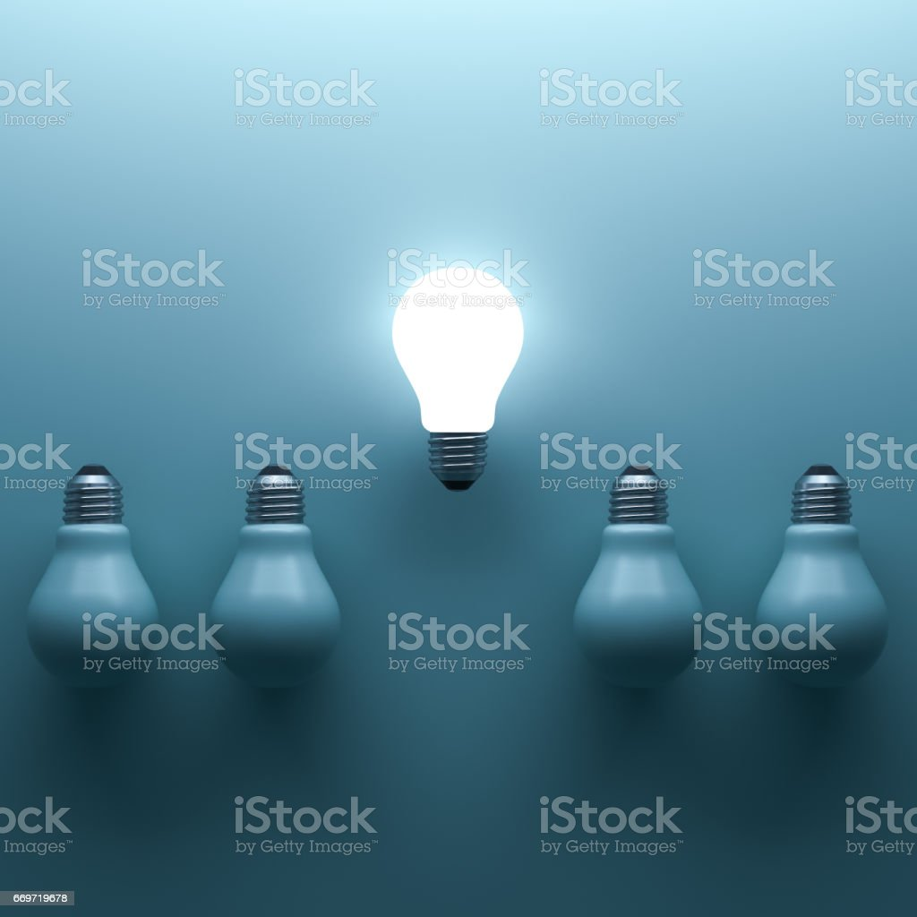 One glowing light bulb standing out from the unlit incandescent bulbs on cyan background with shadow and reflection , individuality and different creative idea concepts . 3D rendering stock photo