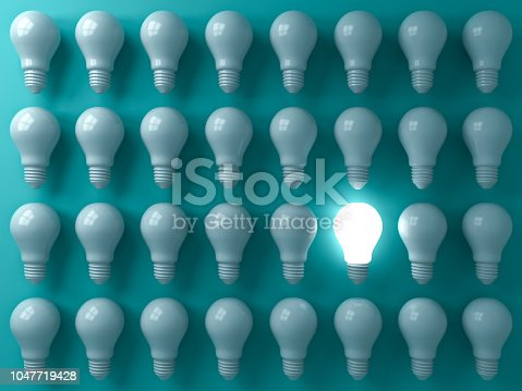 istock One glowing light bulb standing out from the unlit or dim bulbs on dark green pastel color background individuality and think different the business creative idea concepts 3D rendering 1047719428
