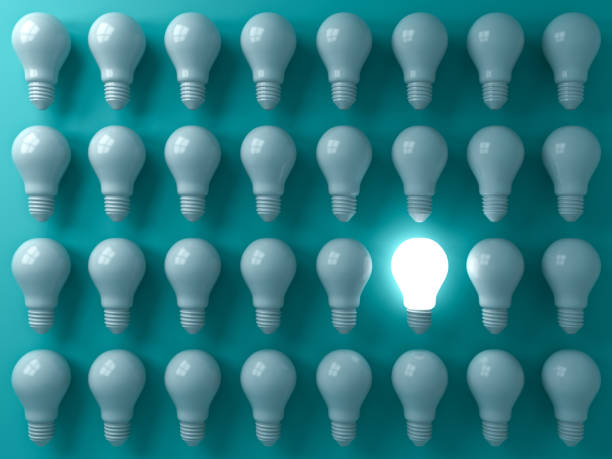 one glowing light bulb standing out from the unlit or dim bulbs on dark green pastel color background individuality and think different the business creative idea concepts 3d rendering - contrasti foto e immagini stock