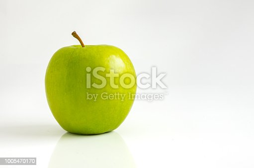 One green apple on white background