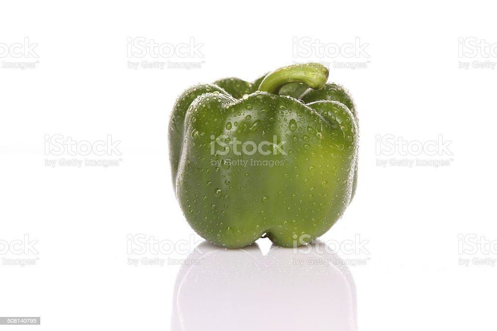 One green bell pepper with water drops stock photo