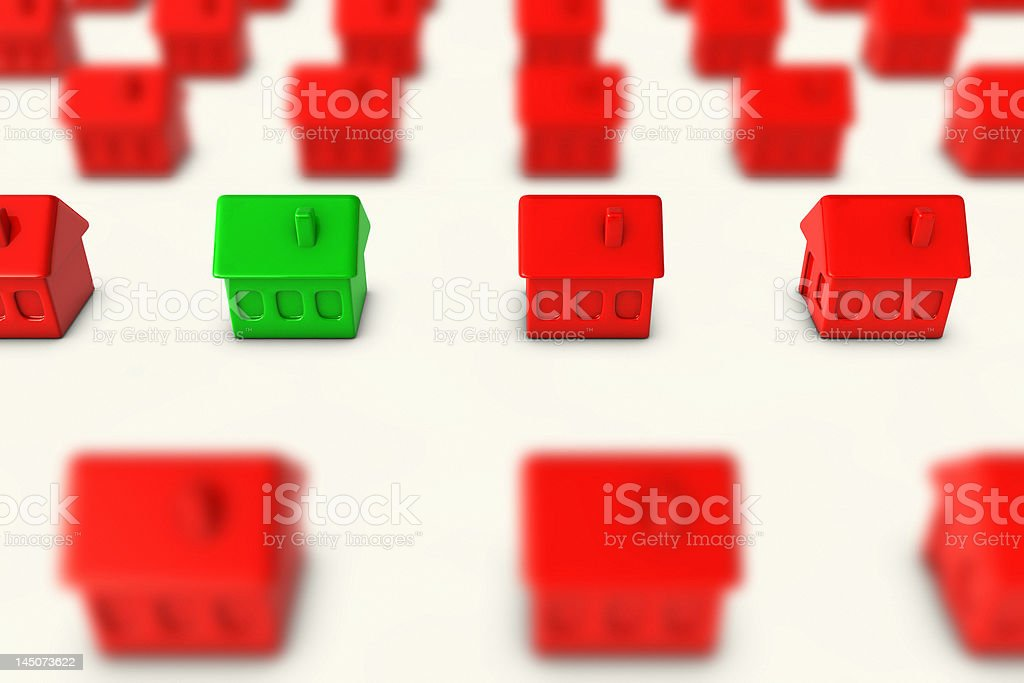 One green house amongst many red houses stock photo