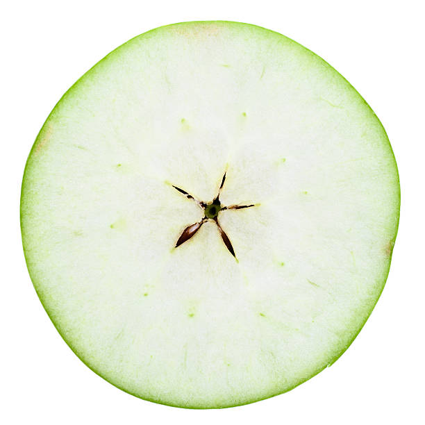 one half of \tgreen apple one half of green apple on white with extremity clipping paths granny smith apple stock pictures, royalty-free photos & images