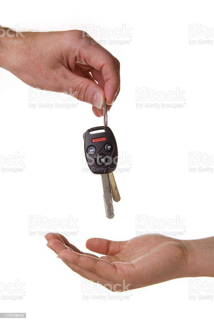 one hand dropping the car keys into another stock photo