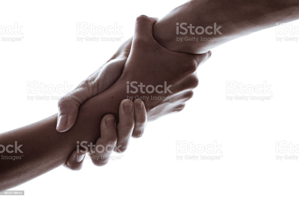 One hand helping another hand stock photo