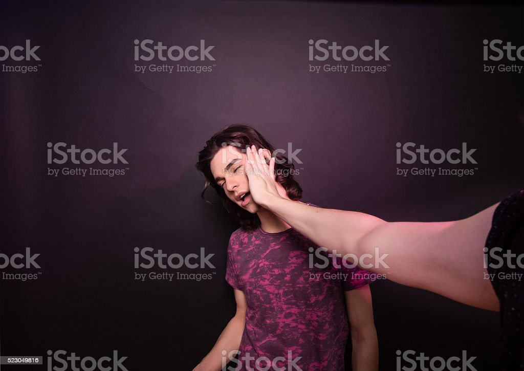 One hand hitting other man face. stock photo