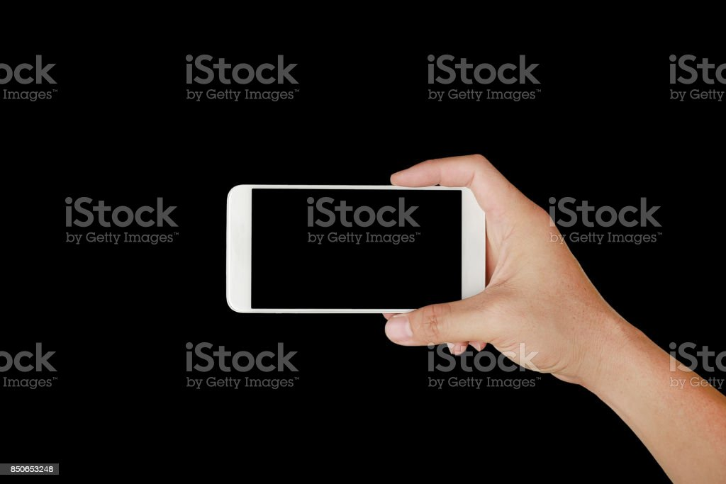 One hand holding mobile smartphone with black screen. Mobile photography concept. Isolated on black. stock photo