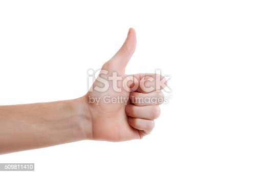 istock One hand making thumb up gesture. Voting hand 509811410