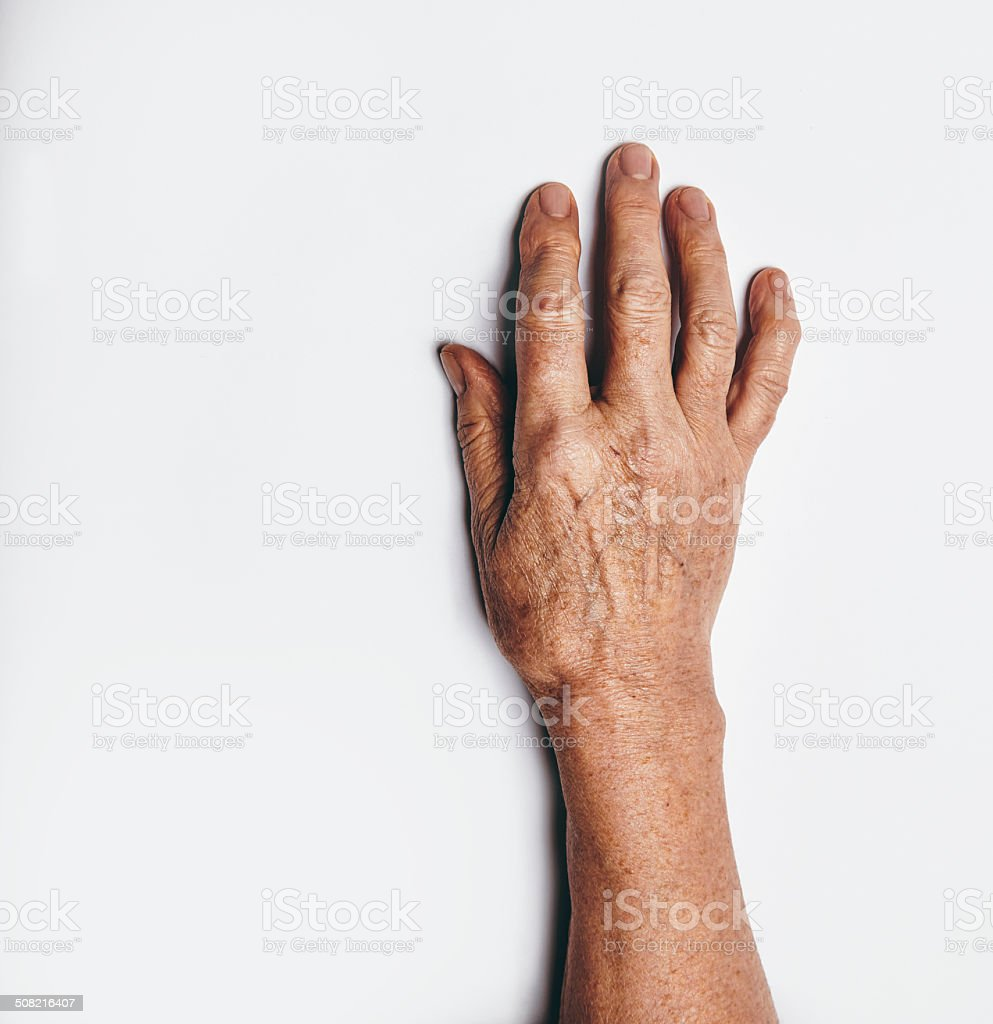 One hand of an elderly woman stock photo