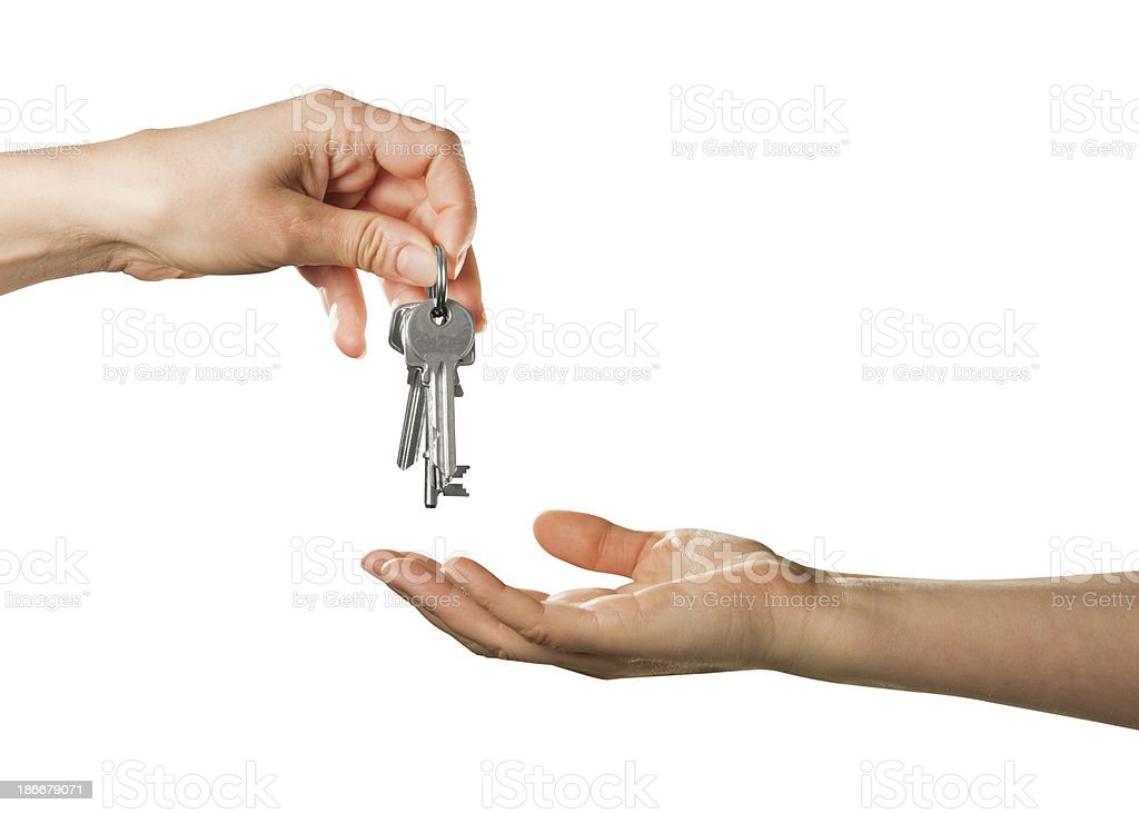 One hand passes house keys to an outstretched palm royalty-free stock photo