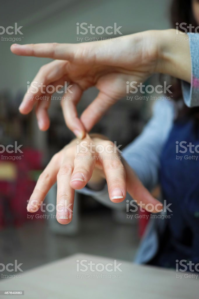 One Hand Pinching the Other stock photo