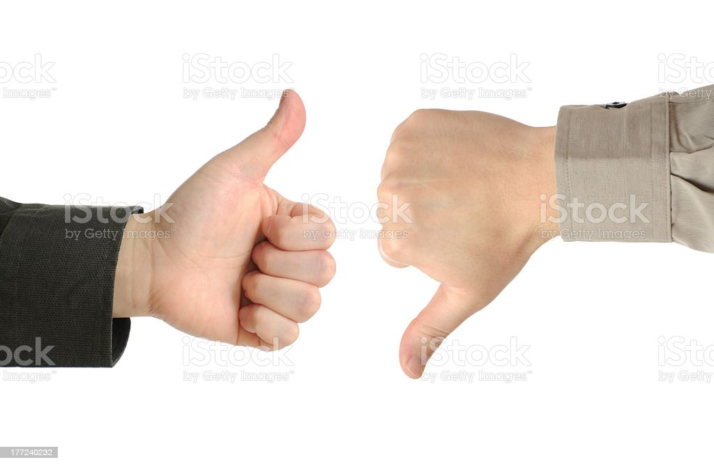 One hand with a thumbs up and one with a thumbs down stock photo