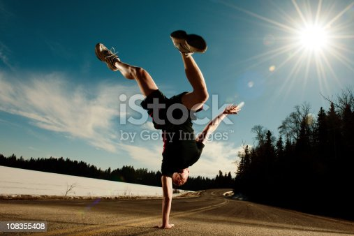 Handstand on the street in winter. -    [url=/file_closeup.php?id=12634153][img]/file_thumbview_approve/12634153/1/istockphoto_12634153-volleyball-player.jpg[/img][/url] [url=/file_closeup.php?id=14619996][img]/file_thumbview_approve/14619996/1/istockphoto_14619996-soccer-kice.jpg[/img][/url] [url=/file_closeup.php?id=11979057][img]/file_thumbview_approve/11979057/1/istockphoto_11979057-gym-workout.jpg[/img][/url] [url=/file_closeup.php?id=14307349][img]/file_thumbview_approve/14307349/1/istockphoto_14307349-run.jpg[/img][/url]  [url=/search/lightbox/4637572/?refnum=CEFutcher#1e3bf354][img]http://terrilynn.chrisfutcher.com/iStock/Extreme_Sports_lightbox.JPG[/img][/url]  [url=http://chrisfutcher.com/is/hel.html][img]http://terrilynn.chrisfutcher.com/iStock/healthy_active_lightbox.jpg[/img][/url]  [url=http://chrisfutcher.com/is/run.html][img]http://terrilynn.chrisfutcher.com/iStock/running_lightbox.jpg[/img][/url]