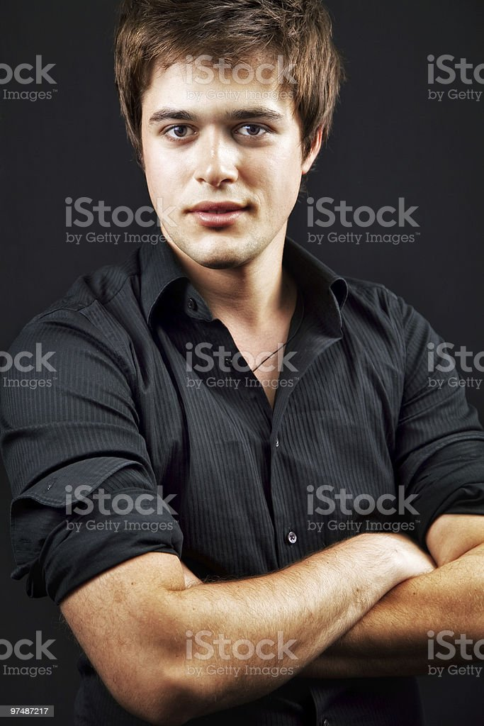 One handsome confident man with arms folded royalty-free stock photo