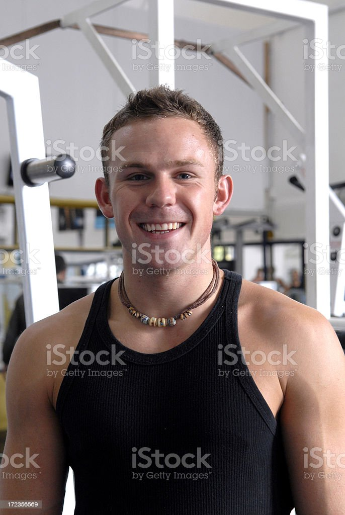 One handsome young man working out in a gym royalty-free stock photo